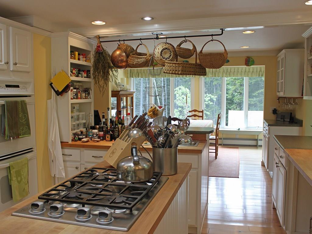 Four burner gas cooktop and double...
