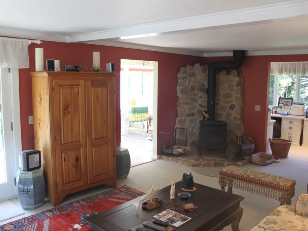Open living area with wood stove and...