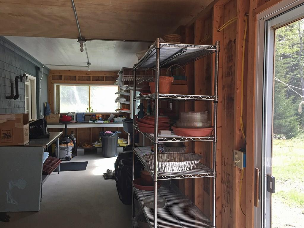 Enclosed porch off basement with two...