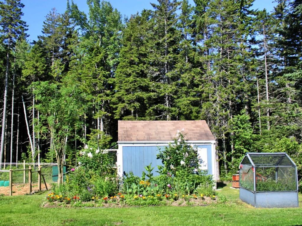 Flower gardens and enclosed herb garden.