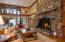 The living area is enhanced by a 30' natural stone fireplace.