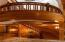 A custom crafted mahogany and cherry, 4-story curved staircase