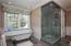 Custom tiled showers define each bedroom suite.