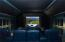 Acoustically enhanced movie theatre room with plush leather seating