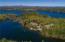 The natural splendor of Lake Winnipesaukee surrounds this majestic setting.
