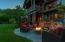 Outdoor patio with gas fire pit overlooking Penobscot Bay, the pool and gardens.