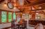 Guest cottage with open kitchen dining and living-room. Exquisite detailing in custom windows, paneling and finishes.