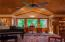 Music room/study which could be an extra guest room with outstanding paneled ceilings and built-in cabinetry and full bath.