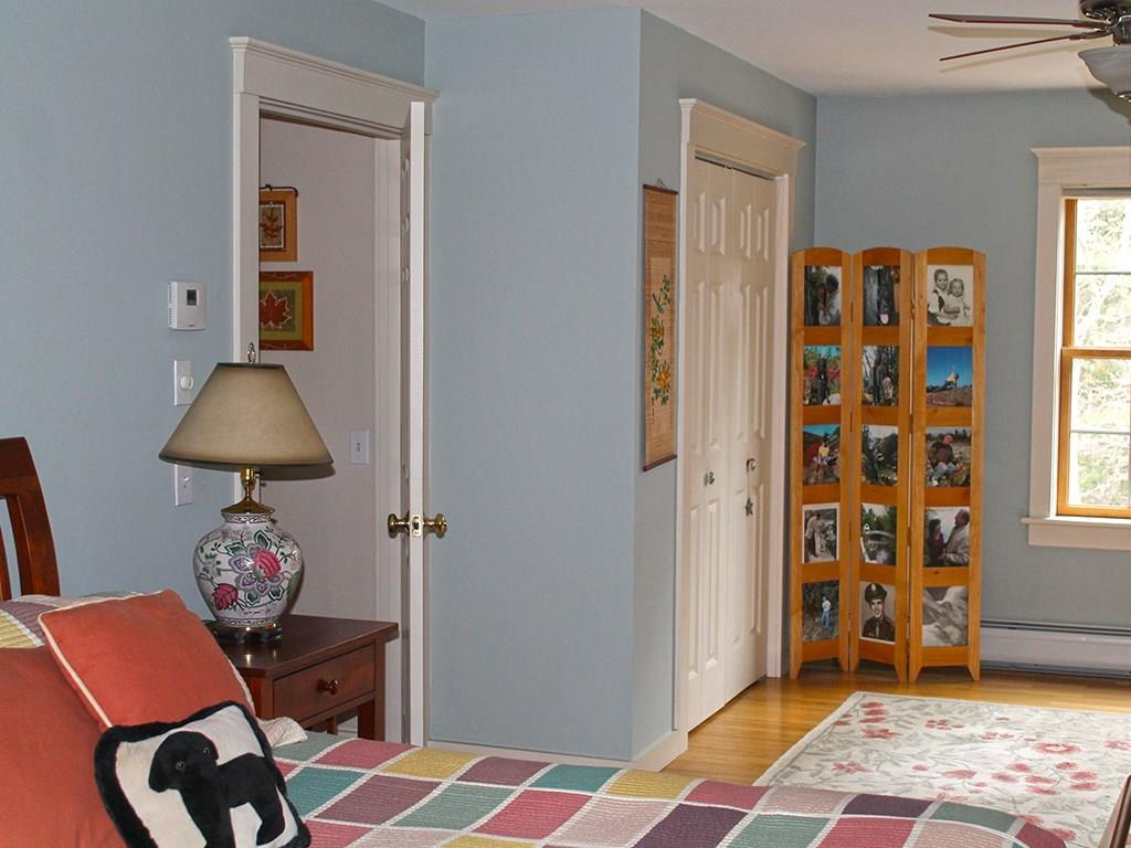 Master bedroom is spacious with a...