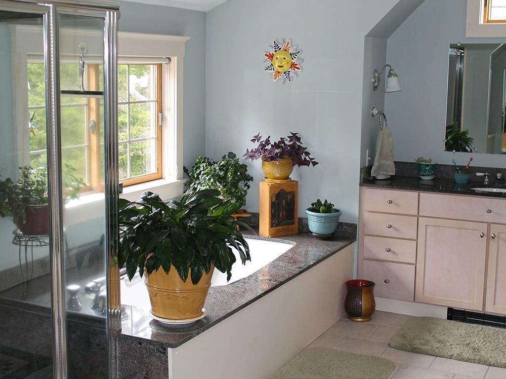Master bathroom with separate...