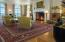 The South Wings starts with a traditional Receiving Room and flows into this glorious Music Room with quarter sawn white oak flooring, soaring 14' ceiling, a huge wood-burning fireplace, and overlooking the Bay