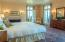 Bedrooms all feature gas fireplaces with beautiful marble or brick surrounds and hearths, and updated tiled private bathrooms. Waterside bedroom windows feature decorative iron balconies overlooking the Bay