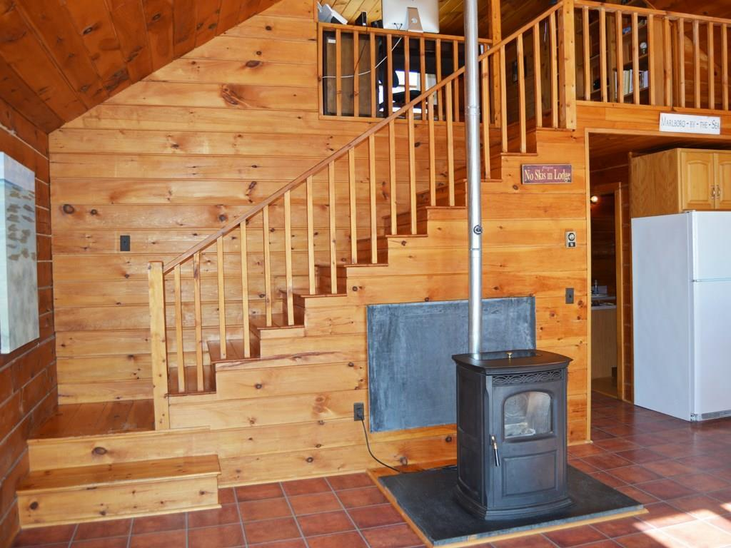 Pellet stove in kitchen with stairs...