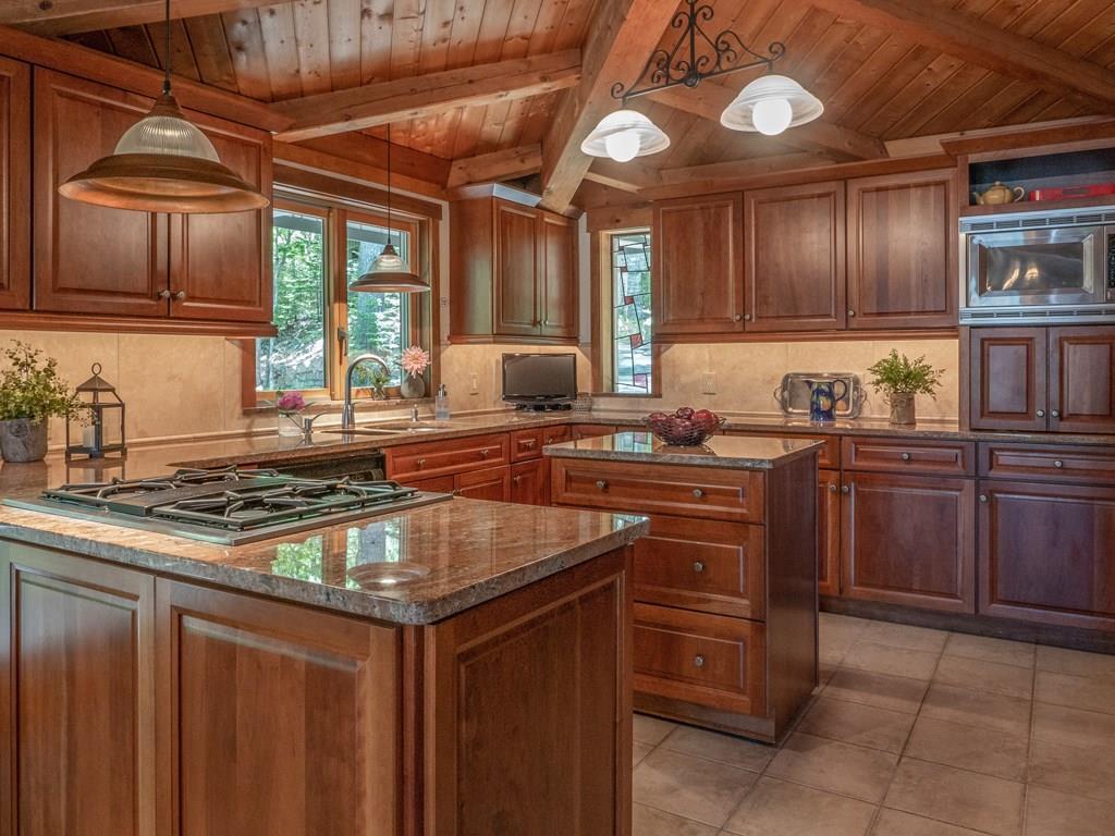 Gourmet kitchen with granite...