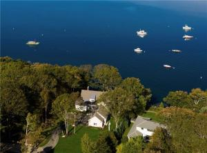 Ideally situated in the seaside community of Yarmouth ~ enjoy sweeping views of Casco Bay and 169 feet of waterfront.