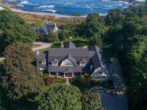 Impressive shingle style residence located in much sought after York Cliffs prominently sited on a beautifully landscaped lot overlooking the Atlantic Ocean and tranquil Pint Cove.