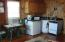 The studio cottage offers a propane stove, sink and refrigerator.