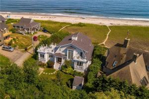 Custom built 4 bedroom home directly on pristine Drakes Island Beach. A meandering footpath across soft dune grass leads to your sandy beach.