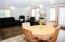 Open concept living/dining area in the in-law apartment with easy access to a large stone patio for barbecuing or just relaxing and enjoying the view. This room is flooded with natural light and spectacular views.