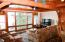 Living area in rental cottage with open area of the lake and beautiful sunrises.