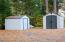 Two sheds that will convey with the property. This area was formerly a tennis court.