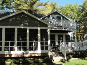 Rear of home is perfect with a large screened porch, 2 decks with vinyl railings and stairs to the fenced in private yard.