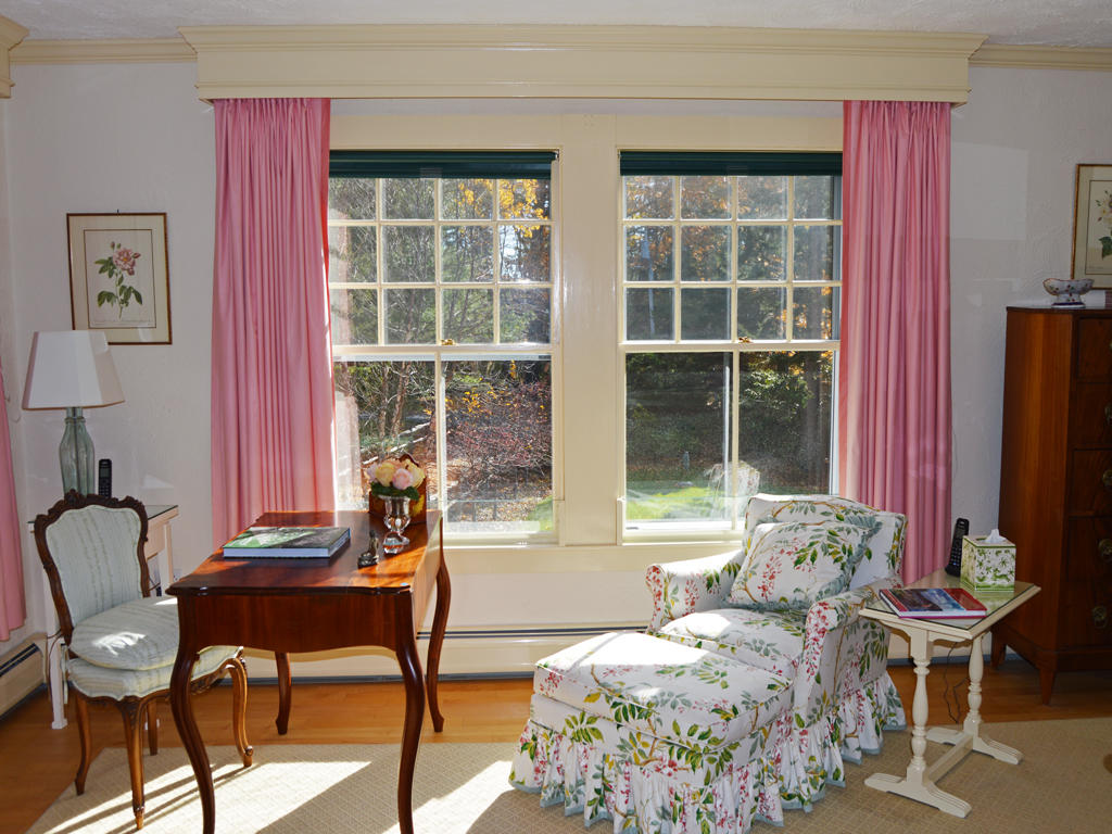 Bedroom 1 overlooking gardens and lawn