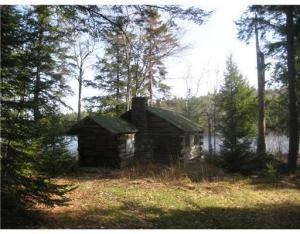 Rustic log cabin 25 ft from the lake with Pleasant Mt. Views. can be renovated and expanded by 1/3, 3.6 ac with 422 ft of lakefront with room to build your dream home or cabin within shore land zone.
