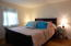 Larger of two bedrooms with ample closet space.