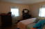 Another view of larger bedroom.