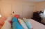 Another angle of view of the larger bedroom with closet in background.