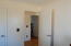 Looking from bedroom/office into hallway leading to living room.