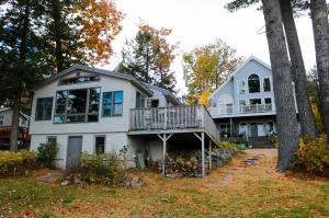 Two homes with waterfront on Long Lake. The cottage built in 2003 has a great rental history. Main house built in 2005 has in-law apartment on garden level. Spectacular sunrises and stunning views.