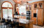 Well designed gourmet kitchen with double wall ovens, custom cabinets, extra large stove top. Cooking and entertaining is inviting in this hand-crafted kitchen with many unexpected extras. A must see!