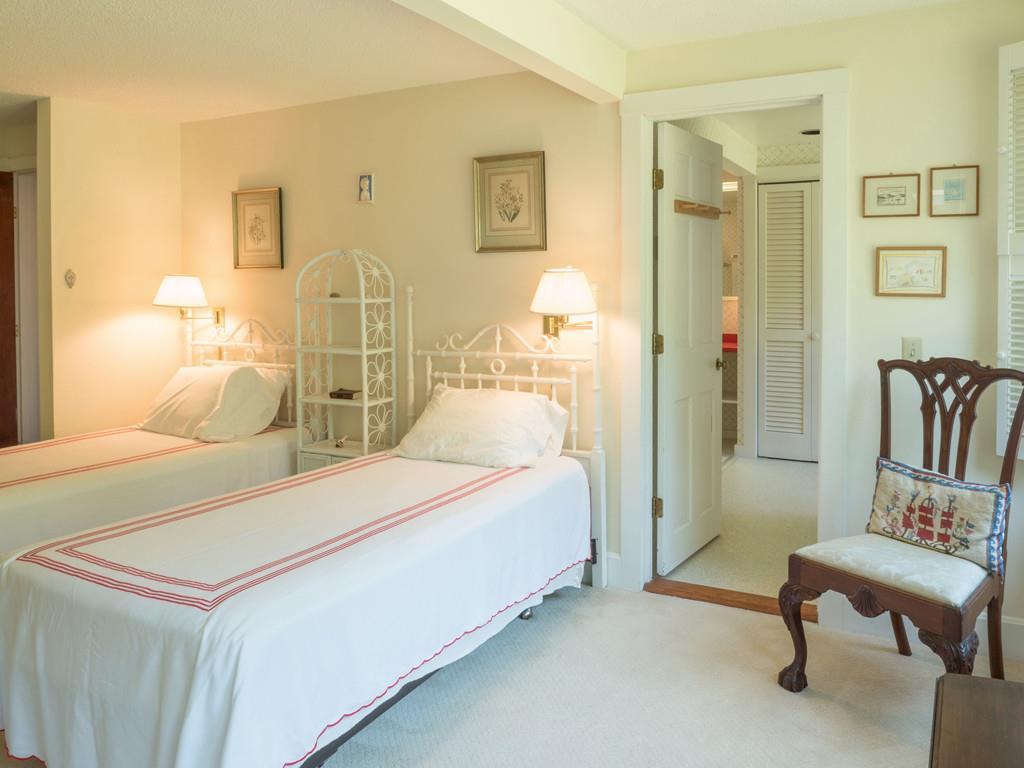 First Floor Guestroom with door to bath