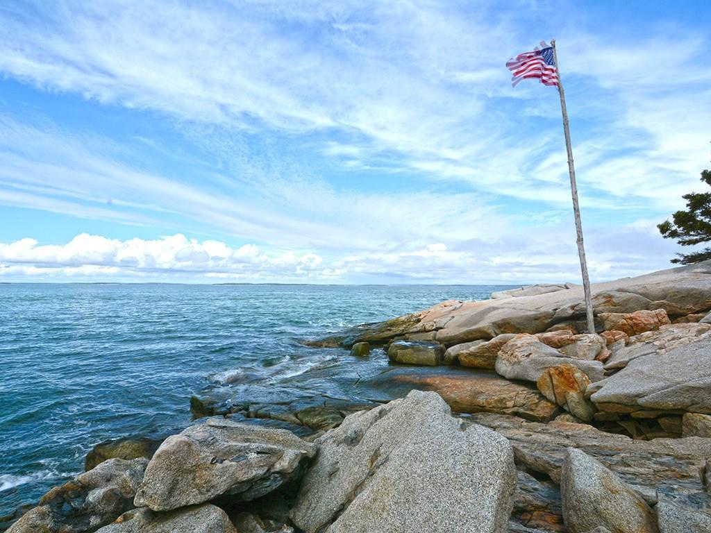 Rock, sky, water.