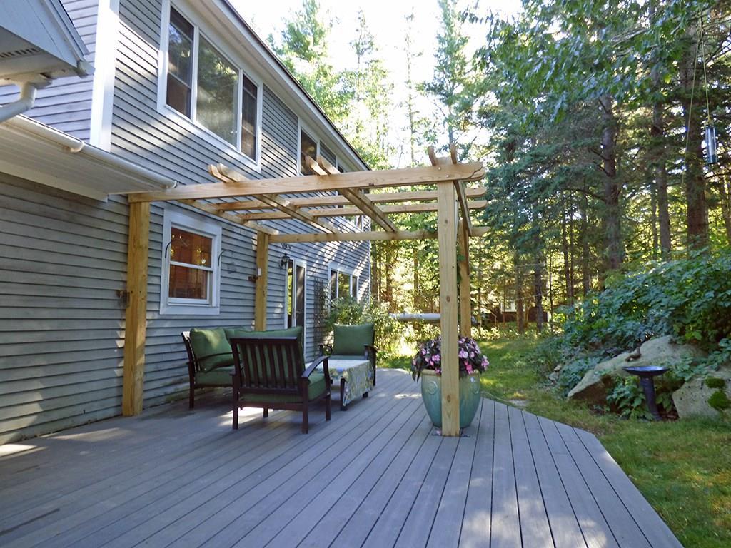 Large deck and pergola showing door...
