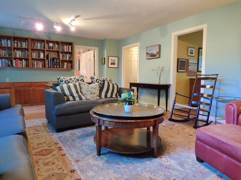 Living room with hardwood flooring...
