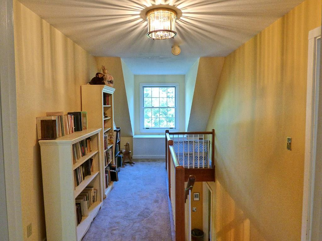 Upstairs landing with a window seat,...