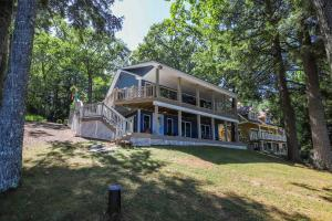 Lakefront property at its finest. Enjoy views of the lake from both levels
