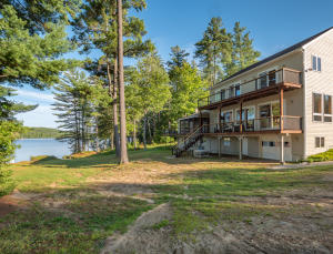 Superb craftsmanship graces this lakeside home. 3.8 acres and 225 ft. of waterfrontage. This is your perfect private setting. Enjoy the beauty of th lake here.