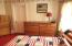 Bedroom has carpet and believed to have wood floor under.