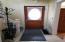 Foyer with beautiful original wood door