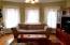 Den is open to Living Room, and door in to the kitchen. Pine floors