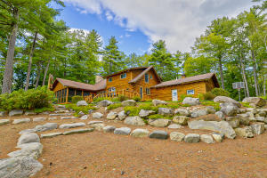 Beautiful log home set on a private lot with stunning views.