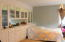 Formal dining room with build in that is currently being used as a bedroom