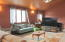 Open concept living room with custom wood cathedral ceilings