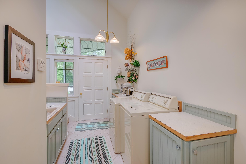 Laundry room with exterior door.