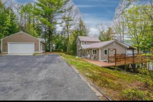 One Year Home Warranty included with the sale! This lovely 4 bedroom, 3 bath lakefront home is located at the end of a private paved driveway with a 2 car garage.