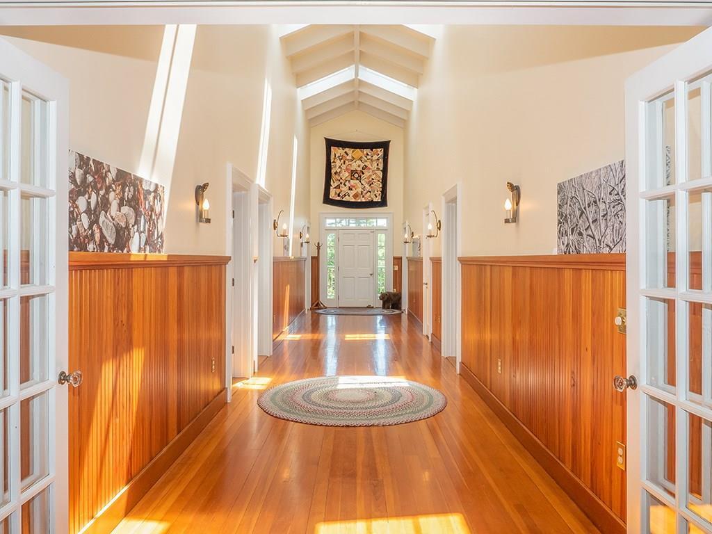 Hallway to front door and art...